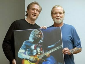 Mark delivering a portrait painting of Duane Allman to brother Gregg