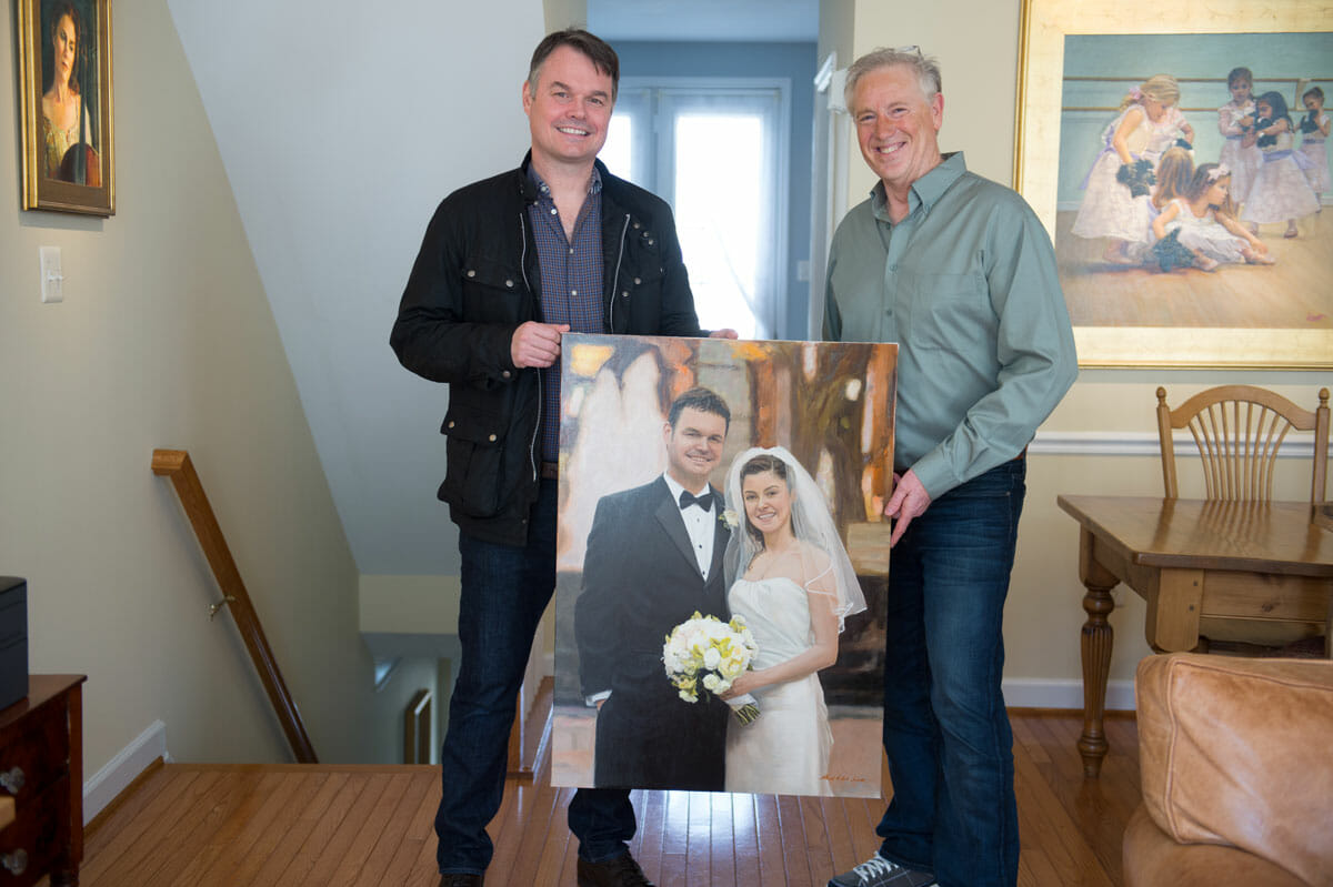 pic of Tom and Mark holding painting
